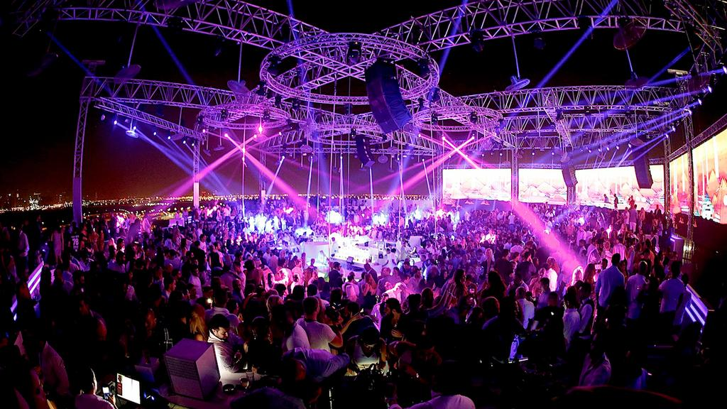 Grab-a-rooftop-drink-at-White-Dubai