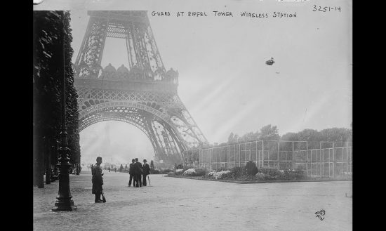 Photograph shows a guard at the Eiffel Tower, in Paris, France during World War